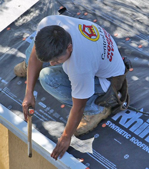 Central Homes roofer working on roof