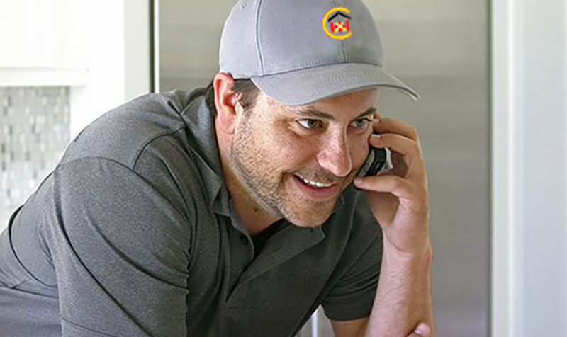 Roofing contractor on phone